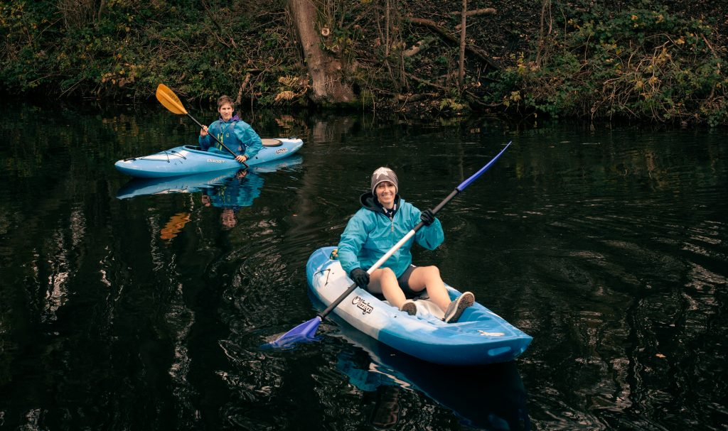 an image of me coaching kayaking to a 14 year old client